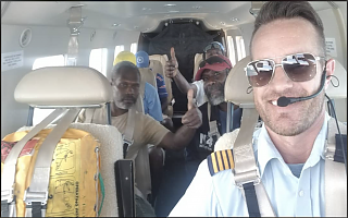Bush Pilot Ryan with happy passengers