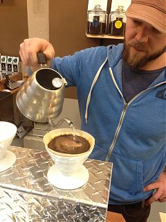 Brewing Hario pours at Second Crack Coffee on Bridge Street.